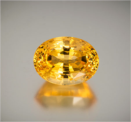 Natural yellow sapphire from Sri Lanka, 27.27 ct, 18.88 x 14.11 x 11.83 mm. It comes with an AGL brief. Inventory #19961. (Photo: Mia Dixon)