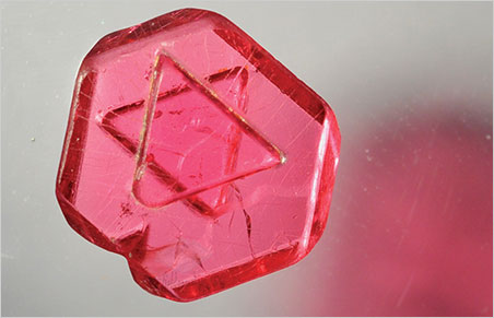 "This fine ""Star of David"" spinel crystal, 1.1 ct, is a macle, reportedly from the Pein Pyit/Pyant Gyi area east of Mogok, which was known for producing such crystals between 2000 and 2005. No processing, slicing, or polishing was performed on this specimen; it is 100% natural. (Photo: Vincent Pardieu, © GIA)"