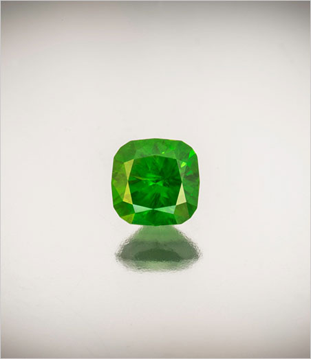 No horsing around. Demantoid garnet, 2.09 carats, cushion cut, 7.38 x 4.81 mm. Inventory #21913. Click to enlarge. (Photo: Mia Dixon)