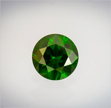 Fir sure, this is a very important gem: evergreen-hued demantoid, 9.61-carat round, 13.02 x 8.2 mm. Inventory #21909. Click to enlarge. (Photo: Mia Dixon)
