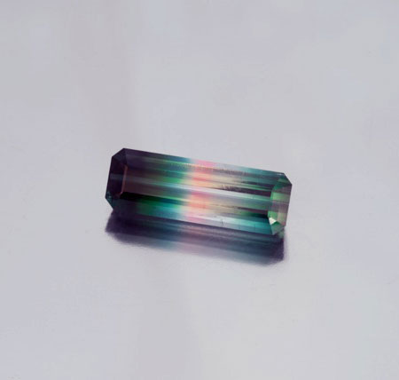 Count the colors. Rare multi-colored Brazilian beauty, 10.59 ct, 24 x 8 x 6 mm. (Photo: Mia Dixon)