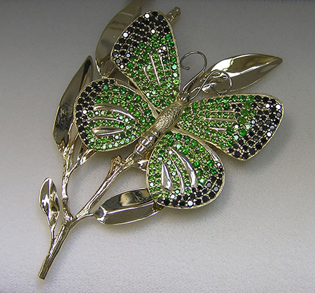 Life-size, lifelike.  The butterfly brooch features a total of 364 gems, 2.78 carats of black diamonds and 5.23 carats of demantoids. The overall size is 3.5 x 2.25 inches. Just as the artist has rendered it here, the real-life Moorland Clouded Yellow butterfly can have contrasting deep black borders on its otherwise light green wings.  Click  to enlarge. (Photos: The Jeweler's Bench)