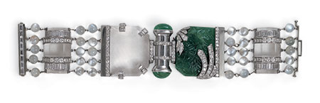 A Seaman Schepps bracelet  found in the collection of Andy Warhol, c. 1940: emerald, rock crystal, moonstone and diamond.  Click  to enlarge. (Seaman Schepps)