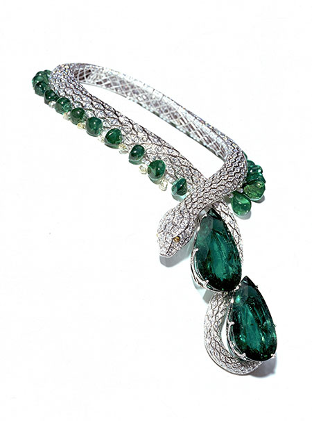 "Snake necklace  named ""Eternity"" in diamond and emerald set with two emeralds weighing more than 200 carats each, Cartier 1997. (Photo: © Cartier/Cartier Archives)"