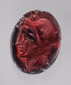Gem no. 8 is a Ptolemaic oval intaglio (16.0 x 13.0 mm) engraved with the head of Dionysos wearing an ivy wreath (late 2nd–1st century BCE). Inv. no. 85.AN.444.22 (gift of Jonathan H. Kagan), J. Paul Getty Museum, Villa Collection. (Photo: Harold and Erica Van Pelt)