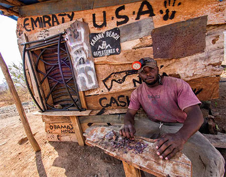A miner named Obama, below, sorts ruby outside his hut at Winza, Tanzania, 2013. (Photo: E. Billie Hughes)