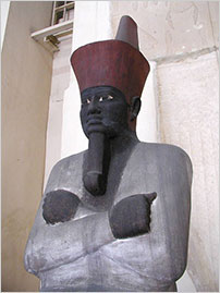 Painted sandstone seated statue of Nebhepetre Mentuhotep II, 11th Dynasty, Egyptian Museum, Cairo. (Photo: Jon Bodsworth)