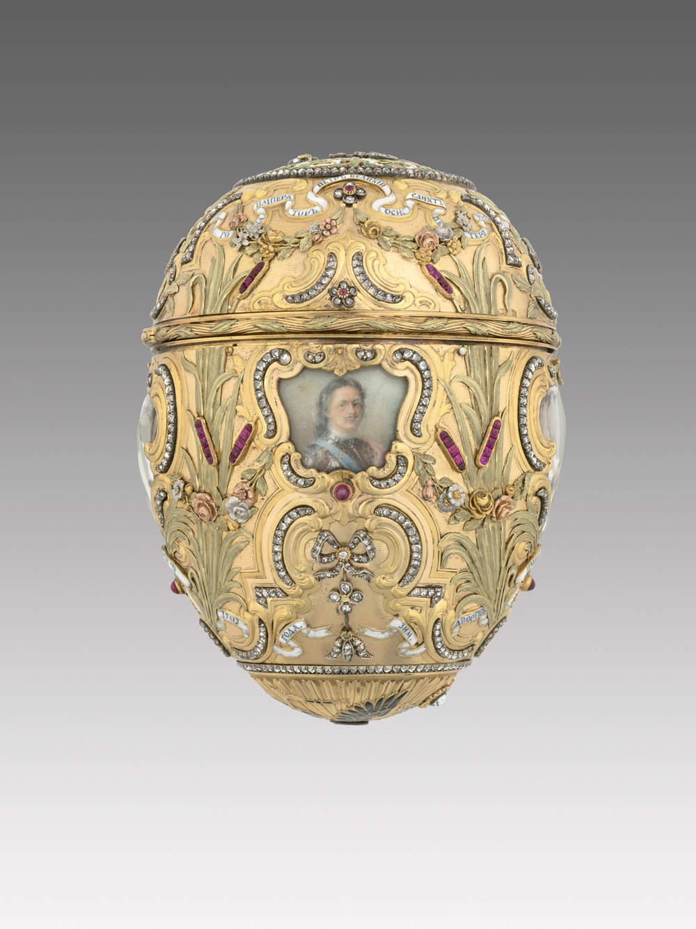 Carl Fabergé (1846–1920), Fabergé workshop, Mikhail Perkhin (workmaster). Imperial Peter the Great Easter Egg, 1903. Egg: gold, platinum, silver gilt, diamonds, rubies, enamel, watercolor, ivory, rock crystal. Surprise: gilt bronze, sapphire. Egg: 12 x 7.9 cm, Surprise: 4.7 x 6.9 cm, Stand: 7.7 x 6.9 cm, Virginia Museum of Fine Arts, Bequest of Lillian Thomas Pratt. This was featured in Faberge, Jeweller to the Czars last year at the Montreal Museum of Fine Arts. (Photo courtesy The Montreal Museum of Fine Arts)
