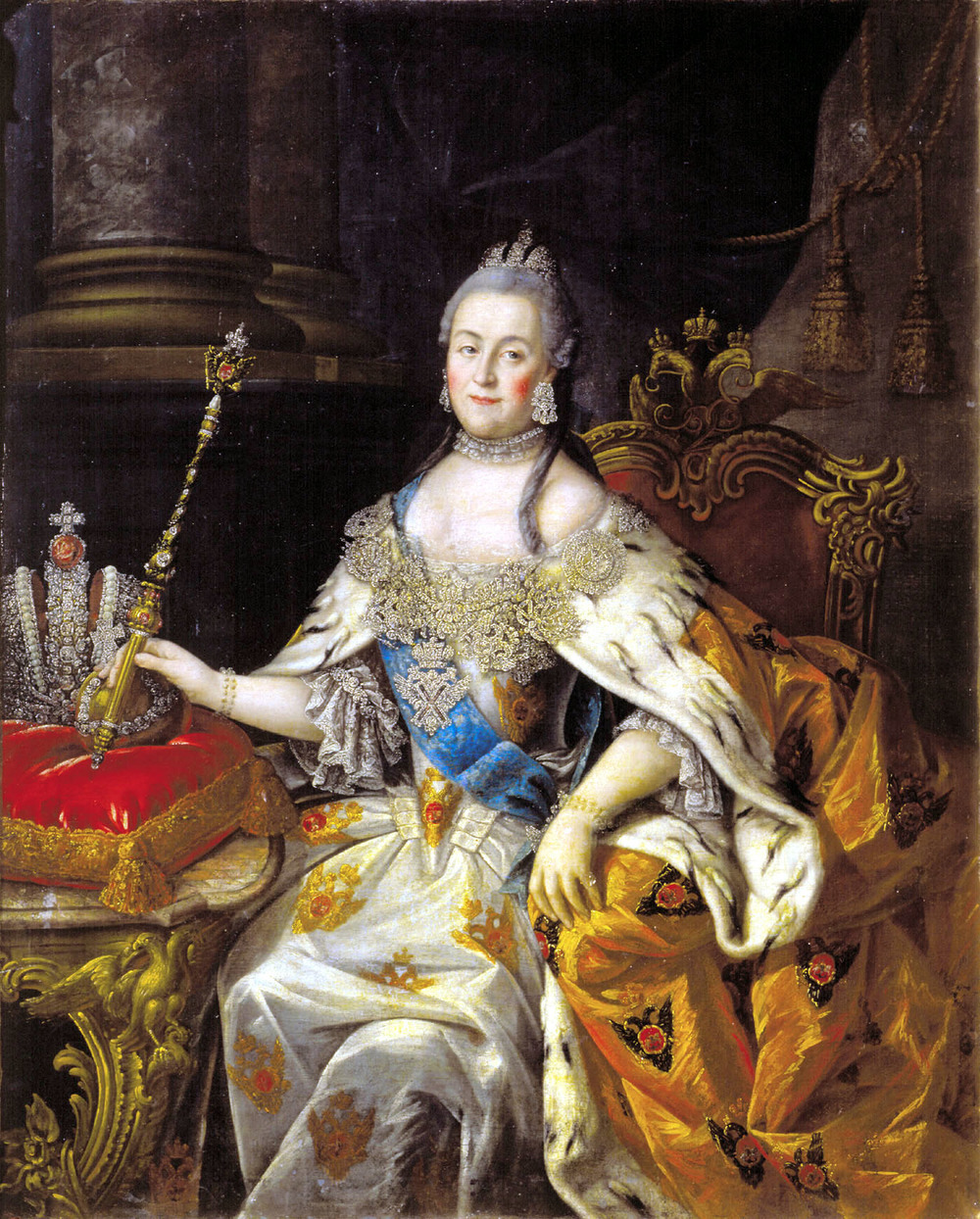 Catherine II (the Great) desired a contemporary coronation crown, in contrast with the traditional sable-trimmed Cap of Monomakh shown below. If Peter the Great is credited with Russia's cultural and political sea change, Catherine was inspired by her predecessor. In the portrait above, painted by Aleksey Antropov about three years after her 1762 coronation, the empress holds the imperial scepter, not yet set with the diamond she received from her former lover Grigory Orloff. The diadem she wears echoes the design of the full-size, five-pound crown at left. Painting by Alexei Antropov, ca. 1765.