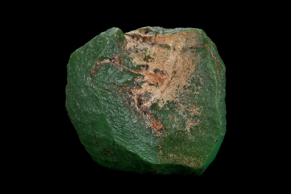 "This twelve pound slick boulder of ""apple green"" jade was found by a sheep herder in 1948. This boulder is precisely what caused the jade hunters to flock to Wyoming after World War II and search for ""Green Gold."" Unfortunately very few jades found were of this caliber. Ben Nott of San Francisco owned this beauty for about 50 years, but sold it at the 2013 Big Sur Jade Festival. (Photo: Robert Weldon)"