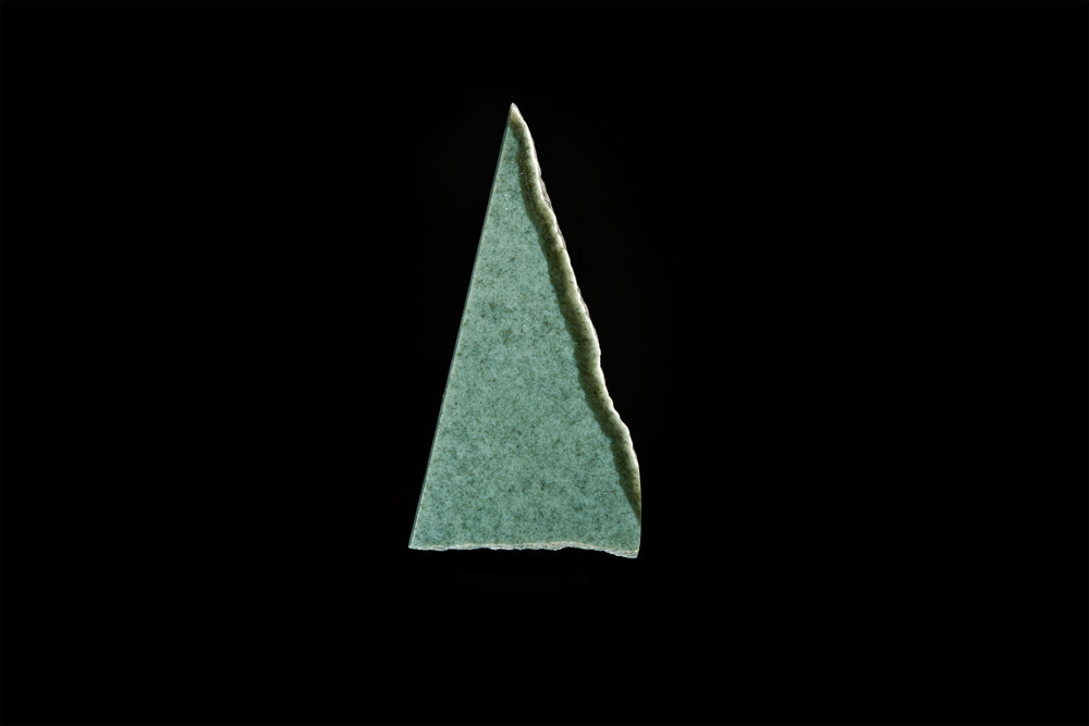 Above is a small slice typical of Wyoming sage green jade that is easily polished.  (Photo: Robert Weldon)