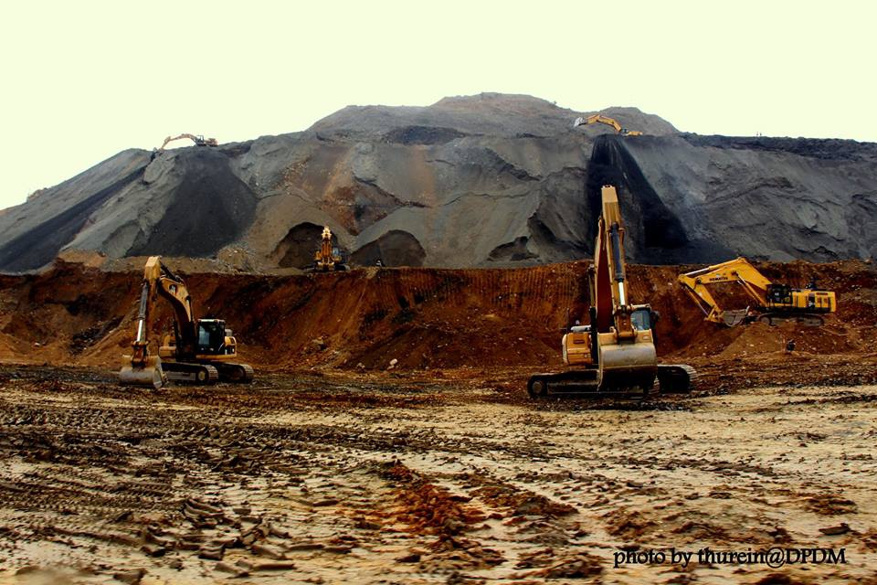 Construction machinery digs through fresh earth at Hpakant, Kachin State. (Photo: DVB)