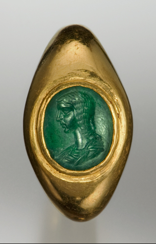A semitransparent emerald of fine bluish green color engraved with a Severan royal portrait of either Julia Domna or Plautilla, set in its original gold ring (ring:  25.1 × 31.3 × 18.9 mm; stone: ca. 11.8 × 13.1 mm). Michael C. Carlos Museum, Emory University, gift of the Michael J. Shubin estate, inv. 2008.030.034. (Photo: Lisbet Thoresen)