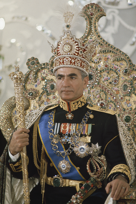 This portrait of Shah Mohammed Pahlavi at his coronation in 1976 includes several items from the royal collection: the Nader Throne, the Imperial Sword (emerald est. 110 ct), the emerald belt (est. 175 ct) and, of course, the Pahlavi crown, commissioned by the shah's father for his own coronation in 1926.