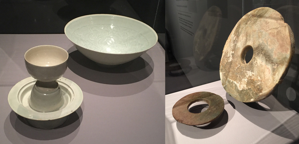 Circles. From Life and Afterlife. At right, two perforated jade disks, or bi, are displayed. They were used in Neolithic burials, with the disks placed at intervals around the deceased. Historical texts describe the bi's shape as being symbolic of heaven. What's remarkable about these and their dating is that jade was not easily carved in the Neolithic period. The larger disk is from the Liangzhu Culture, 10th millennium–21st century B.C.E. The smaller disk is from the Xia Culture, Shang Dynasty of the Late Neolithic, 10th millennium–11th century B.C.E. Quingbai porcelain, at left, was developed in the late 10th and early 11th centuries C.E. Delicate in form, it actually is sturdy, and its celadon glaze is a personal favorite of your editor. The cup and stand, from the Northern Song Dynasty (10th–12th century C.E.) would have been from a set used to warm alcoholic drinks. (Photos: David Hughes)