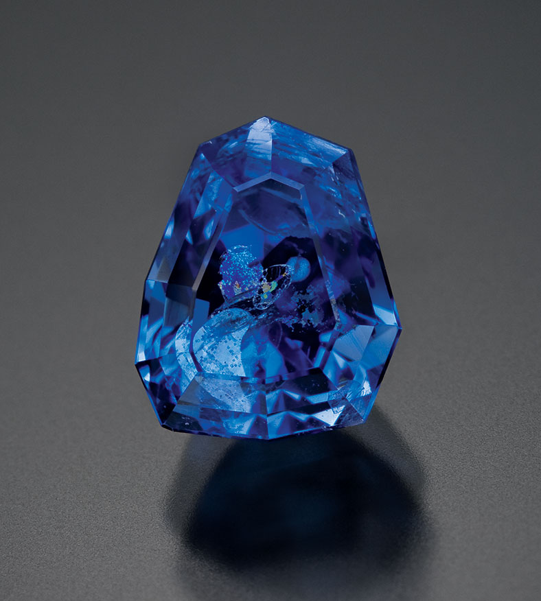 A 1.48-carat carletonite—the largest faceted example known. Art Grant was famous for faceting the most unusual and most difficult mineral species; many also record-breaking in size. (Photo: Michael Bainbridge, Canadian Museum of Nature Collection)