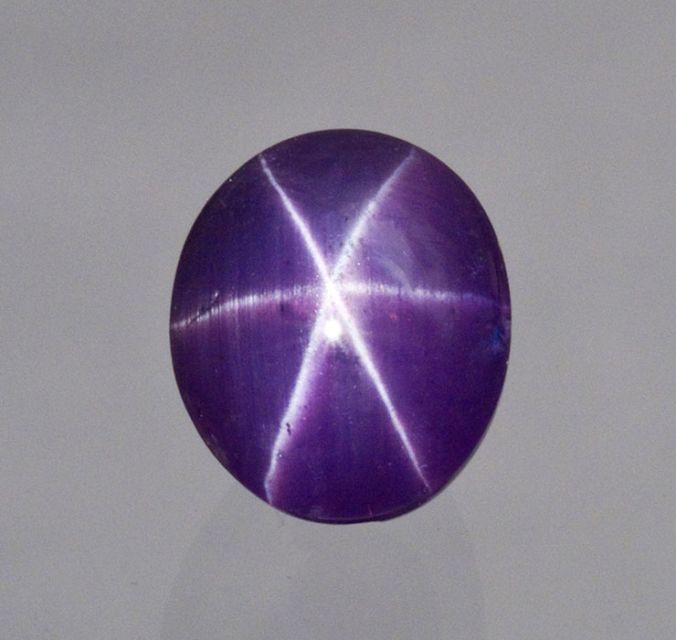 Sri Lankan purple star sapphire, 6.32 carats. It's unusual to find a natural star sapphire of any color with such a well-centered star, distinct full rays and strong color saturation. Pala International. (Photo: Mia Dixon)