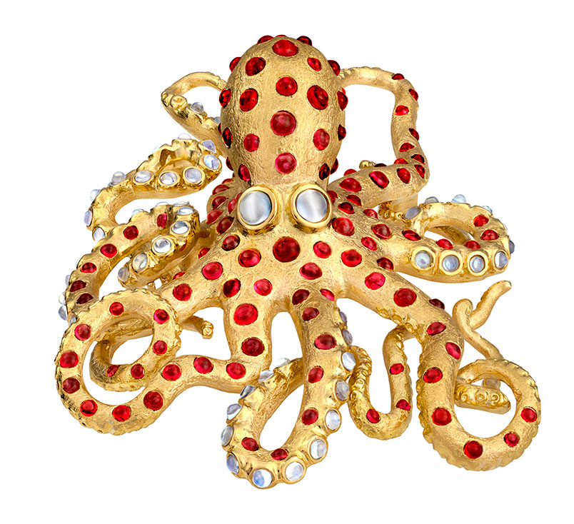 """Ula the Octopus""  by Paula Crevoshay (a favorite of Eloïse) is created in gold with Burmese spinels and moonstones. It will be paired with a twinned crystal of rough red spinel from the museum. The jewel is in the collection of Pala International's Jeanne Larson. ""We love octopus,"" Bill Larson said, and the Burmese provenance of the gemstones sealed the deal. (Two years ago, while at the Denver mineral show, Will Larson raved about a dish of octopus prepared at Rioja, one of the city's premier restaurants in Larimer Square.)"