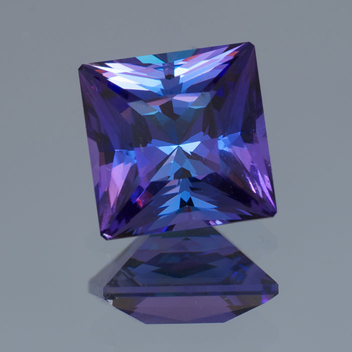 Multi-color effect in tanzanite. Tanzanite is one of the few trichroic gems, meaning that it may exhibit three colors: red, blue and brown. The 2.50-carat unheated gem pictured shows two colors, purple and blue, in the face-up mosaic. (Photo: Gene Flanagan, Precision Gem)