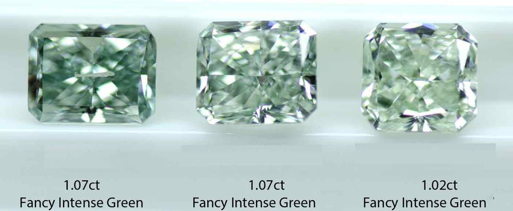 "Three fancy color green diamonds with identical GIA-GTL grades of Fancy Intense Green. Note the vast range of saturation and tone within this grade and the steely green hue. To call the 1.02-carat gem ""intense"" green is surely a reach. (Photo: Stephen Hofer)"