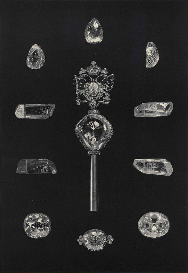 "Plate LII from the 1925 catalog, the ""Orlov"" diamond and the ""Shah"" diamond. The scepter at center holds the ""Orlov,"" which measures 32 x 35 x 21 mm. The catalog gives its weight as 185 carats, but also states, ""The jeweler A. K. Faberger [sic] remembers that the «Orlov» fell out of its [containing] bowl and being then examined by the Trustees, its weight was found superior to 185 acc. (Unfortunately Faberger's records have been destroyed.)"" Its weight is now reported to be 189.62 carats, but that remains an estimate, according to Wikipedia.     The ""Shah"" diamond, at 1.5 inches long, was likened to ""the cut glass stopper of a decanter"" by the New York Times in 1922. Four views of the diamond, inscribed in Arabic, are shown here."
