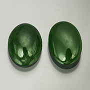 Post-JADE Act jade, anyone?  These natural jadeite cabochons from Burma have a combined weight of 7.23 carats and come with a GIA cert. Inv.  #23175 . (Photo: Mia Dixon)