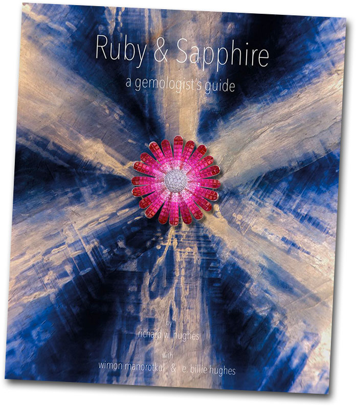 "The background image on the cover of Ruby & Sapphire: A Gemologist's Guide is itself an award-wining photomicrograph for which the book's author Richard Hughes received honorable mention from Gem-A in 2014 (see our ""Tiny Lights"" from January 2015)."