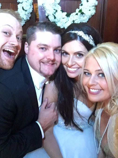 The happy couple is flanked by Maid of Honor Becca Wilson and Best Man Miles Kvalheim. (Selfie by Becca Wilson)
