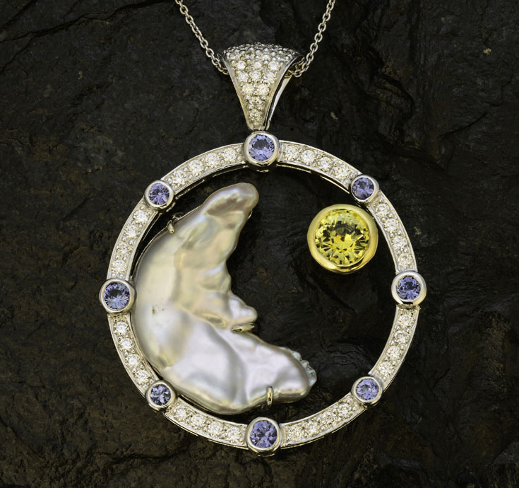 "From Chapter 19, Creating Unique Pearl Jewelry with Colored Gems, ""man in the moon"" pearl from Baja California, Canadian diamonds, and Yogo blue sapphires and yellow sapphire from Montana. North American Wonders pendant design by Alison Larson for Pala International. (Photo: Mia Dixon)"