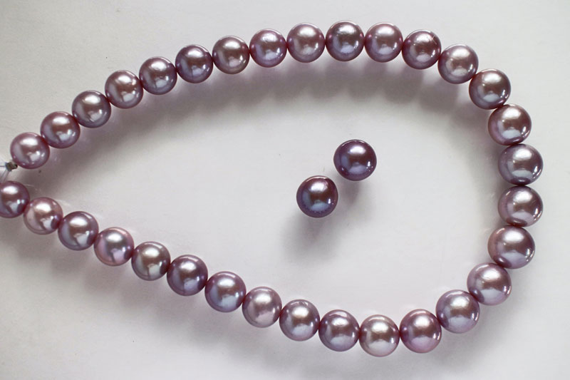 From Chapter 12, Freshwater Pearls. Round gonad-grown beaded Edison cultured freshwater pearls (11–14 mm, natural color). Necklace from King's Ransom. (Photo: John Parrish)