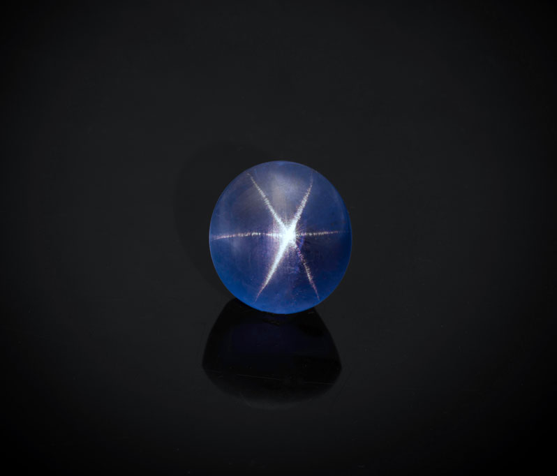 Natural star sapphire from Sri Lanka, 10.36 ct, 11.45 x 10.61 x 8.45 mm. Inventory #23712. (Photo: Mia Dixon)