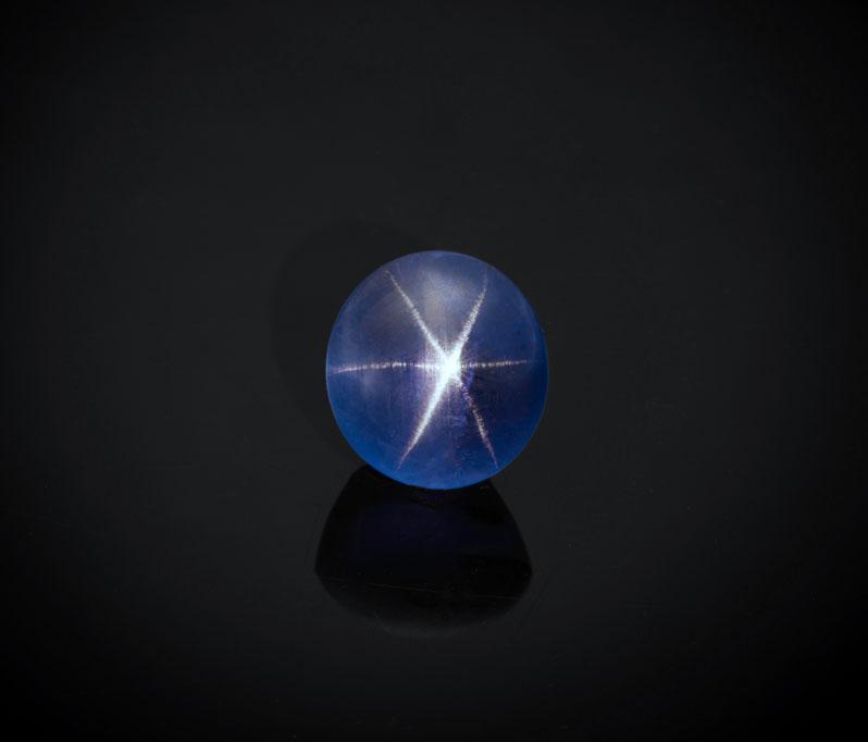 Natural star sapphire from Sri Lanka, 10.36 ct, 11.45 x 10.61 x 8.45 mm. Inventory #23712. (Photo: Mia Dixon)