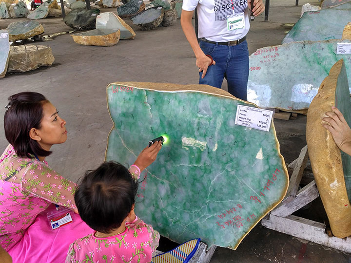 Examining jade at a sale in 2015.