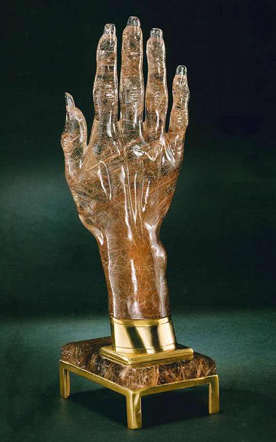 Rutile Hand; 8 in. A life-size copy of the hand of Erica Van Pelt, wife of the artist, on a base of rutilated quartz. (Photo © 2010 Harold and Erica Van Pelt, courtesy Bowers Museum)