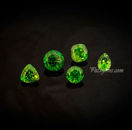 Russian Quintet.  Demantoid garnets from the Kladovka mine in the Ural Mountains. These stunning stones were mined in 2004 but only recently cut by master Marty Key. The 2.57-carat round is the finest green of this material's production. (Photo: Mia Dixon)