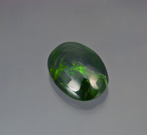 21.22 cts. deep chrome green diopside cabochon from Tanzania. (Photo: Mia Dixon)