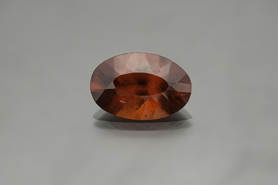 16.27-carat oval brilliant South African rhodochrosite, 20.21 x 13.41 mm. From Ron Gladnick's collection. (Photo: Mia Dixon)