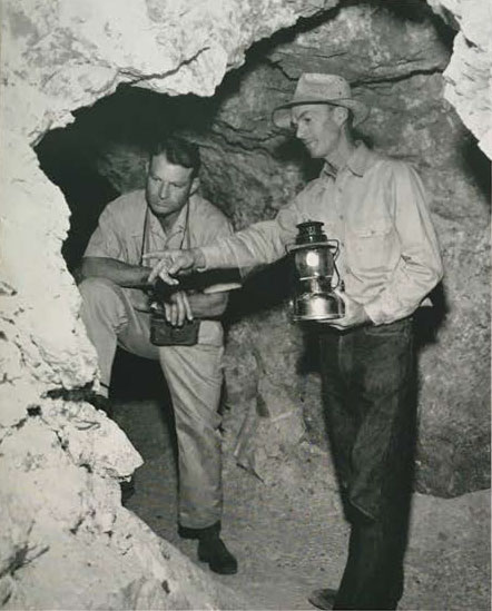 In one of his mines near Pala, George Ashley, right, points out mineral specimens to Roy M. Kepner, Jr., of the County Division of Natural Resources.
