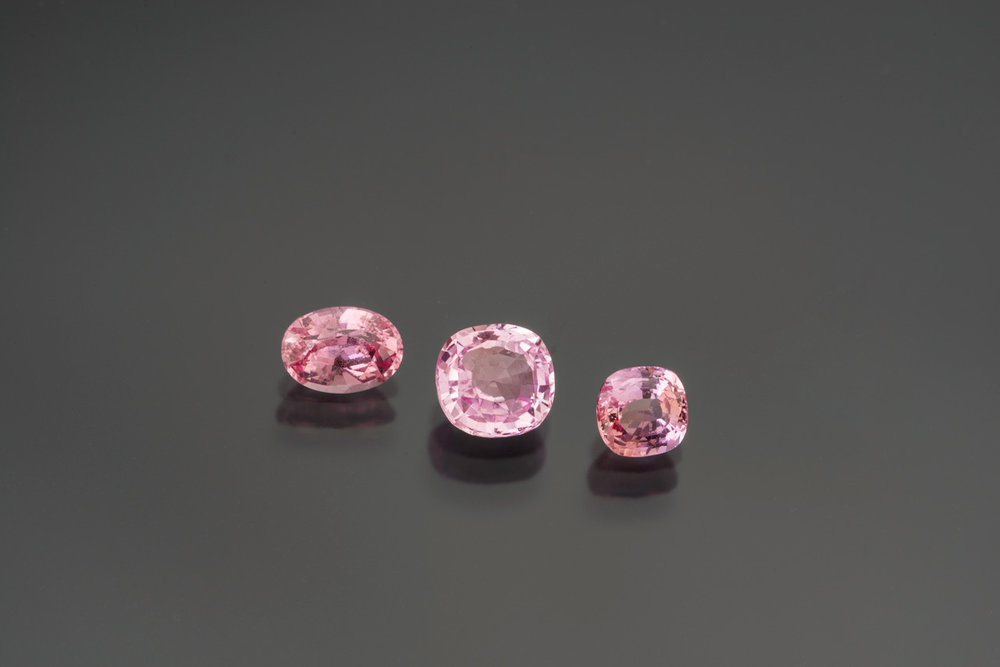 Padparadscha sapphires: 1.25 cts (#23778), 1.71 cts (#23565), and 1.03 cts (#23777). (Photo: Mia Dixon)