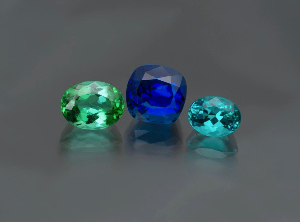 A 4.49 ct. natural no heat Brazilian Paraiba is the centerpiece. With the look of a fine Kashmir sapphire, most would assume just a fine blue sapphire. On the right a 1.83 ct. no heat Brazilian Paraiba in more of the classic Caribbean blue. On the the left a 2.93 ct. minty green Brazilian Paraiba. (Photo: Jason Stephenson)