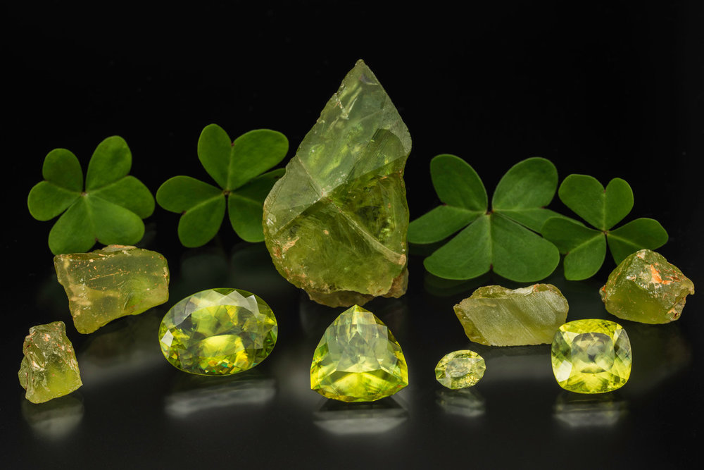 Rough and cut sphene from Zimbabwe. Faceted stones from left to right are  29.91 cts,   21.31 cts,   2.86 cts  and  14.64 cts.  Happy St. Patrick's Day! (Photo: Mia Dixon)