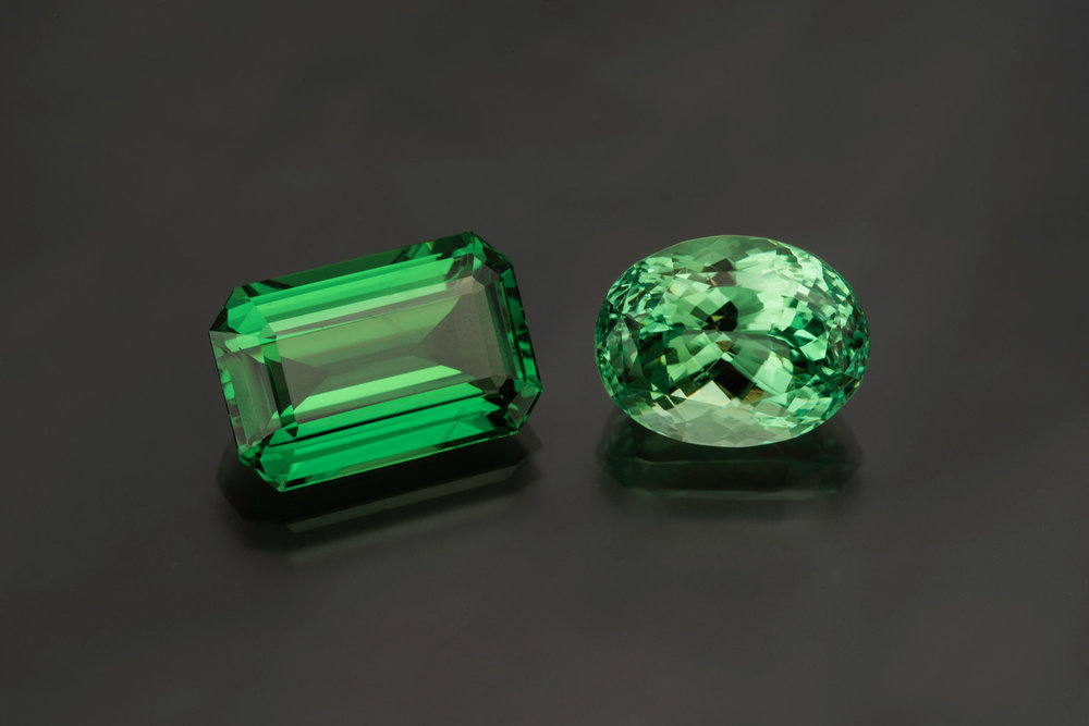 A lovely comparison, grossular garnets from Tanzania. The tsavorite is 12.63 cts and the mint grossular is 11.33 cts (Photo: Mia Dixon)