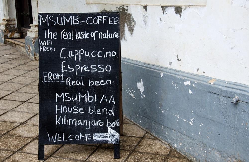 Coffee shop in Stone Town (via smallthingsinbignumbers.com)