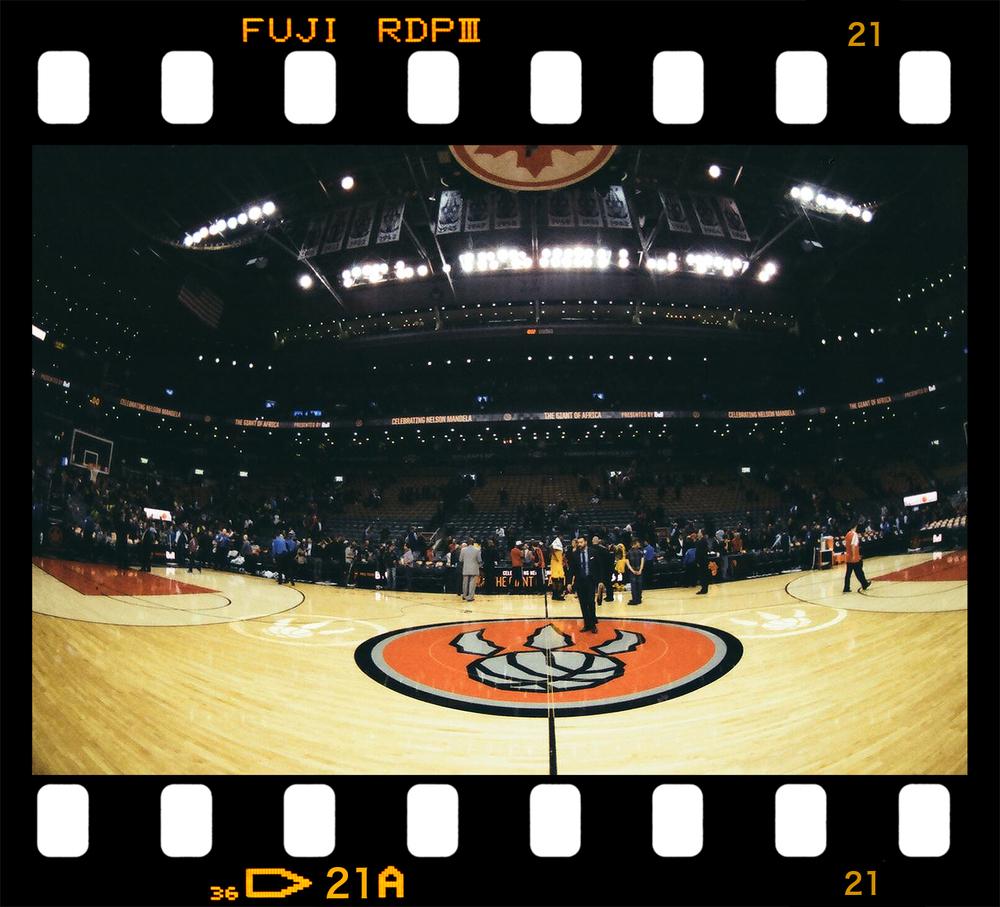 3Bphoto_NBAPhotographer_ClevelandCaveliers_TorontoRaptors_LBJ_TheKing_KingJames_LebronJamesLayup_Photography_LebronDrivingVSJamesJohnson-Jumpshot-Air-Canada-Centre-Fisheye-Lens-Film-Kodak-Gold-Raptors-Centre-Court-Air-Canada-Centre.jpg