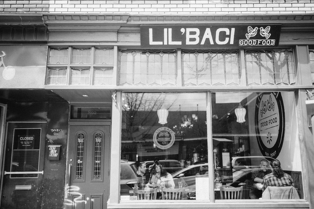 Toronto Wedding photographer engagement shoot at Lil'Baci - couple having brunch