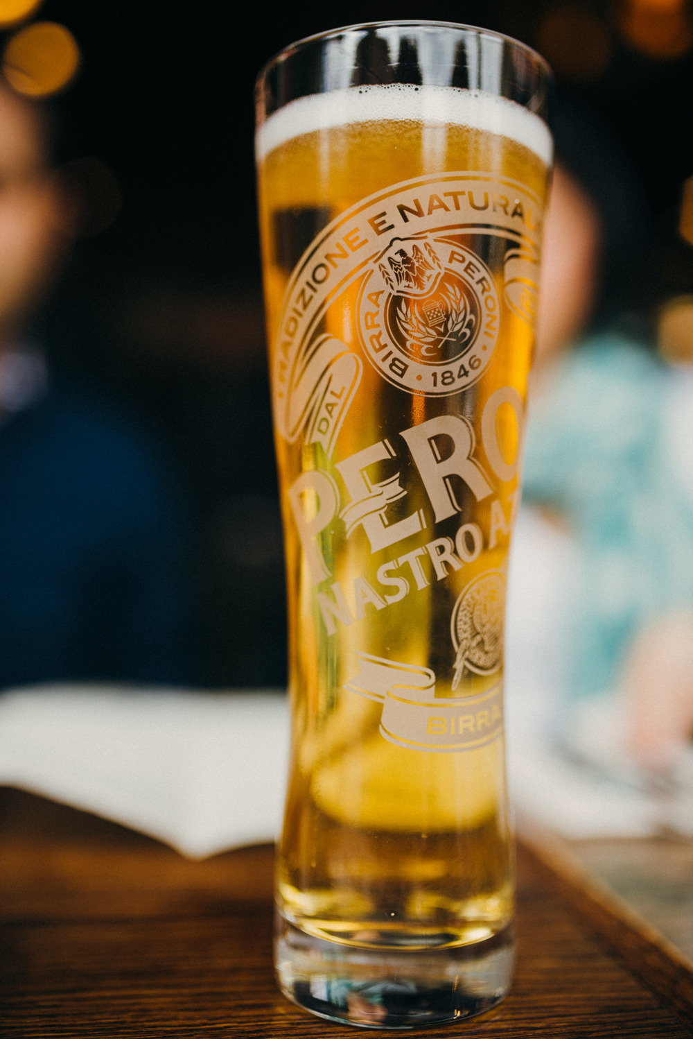 Detail shot of beer at Lil'Baci engagement shoot
