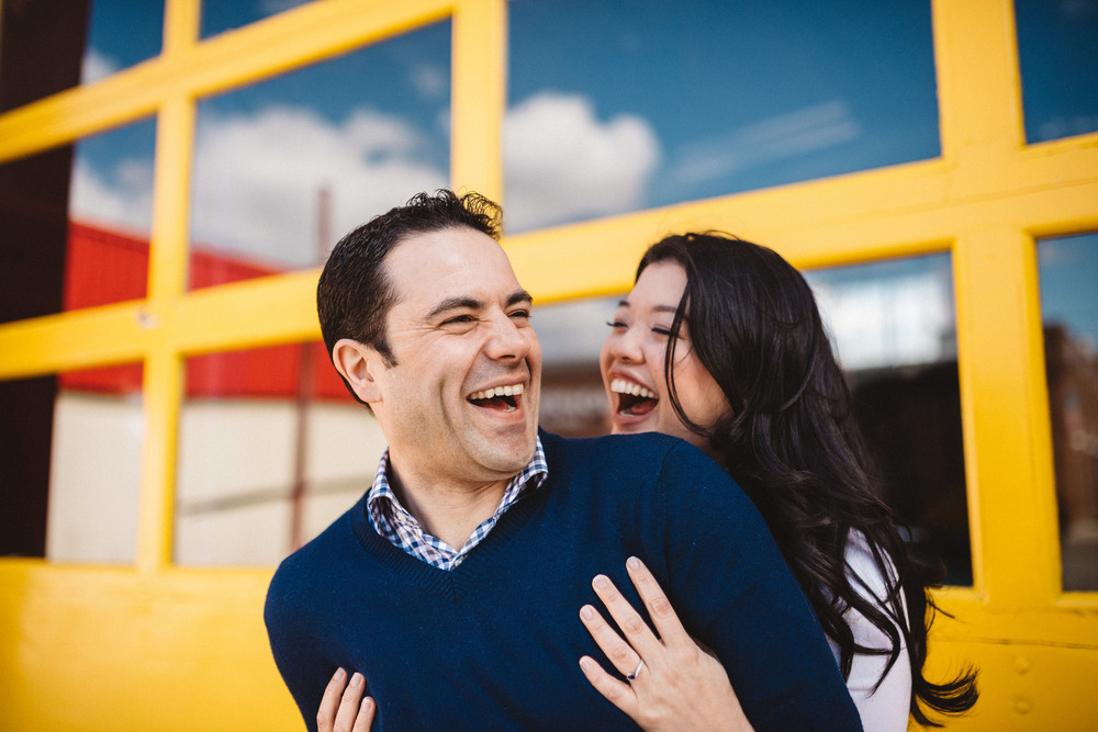 Couple laughing at engagement shoot in Leslieville