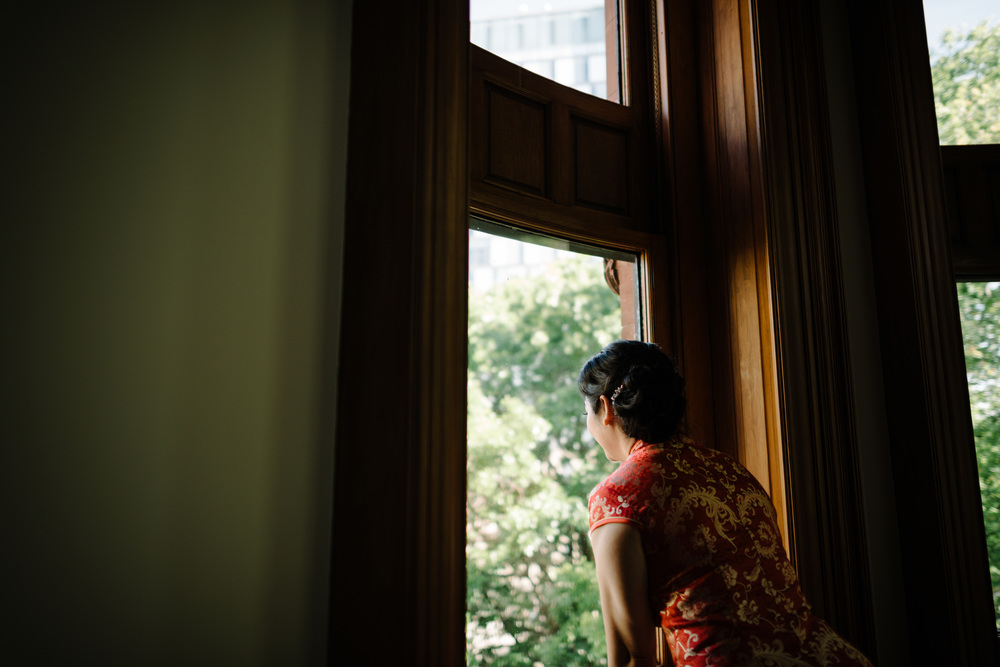 Bride looking out over the ceremony space of downtown Toronto wedding