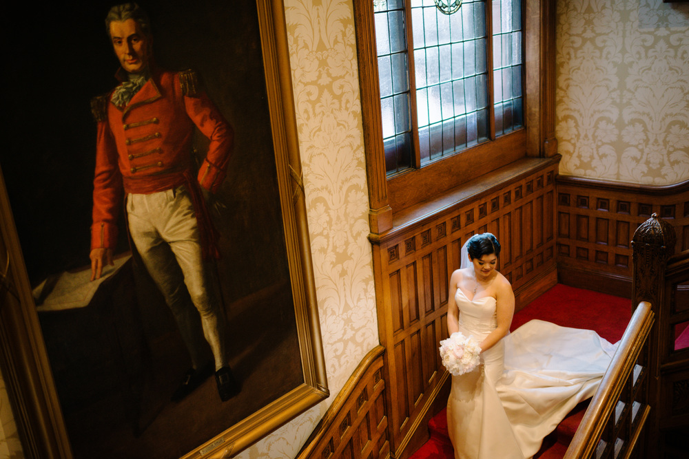 Dramatic portrait of bride on her wedding day, vintage private club in downtown Toronto