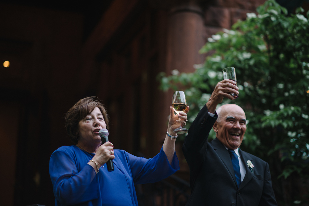 Mother and Father of the groom toast the happy couple, captured by Toronto Photojournalist